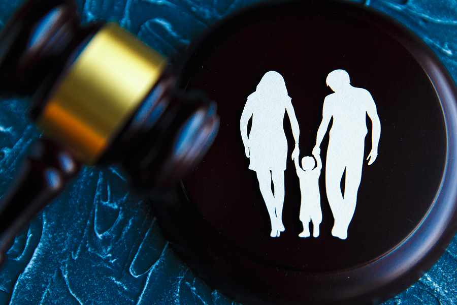Cutout family imagery and a gavel. Family Law concept