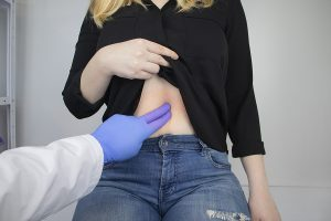 A woman being checked by a specialist gastroenterologist in Melbourne