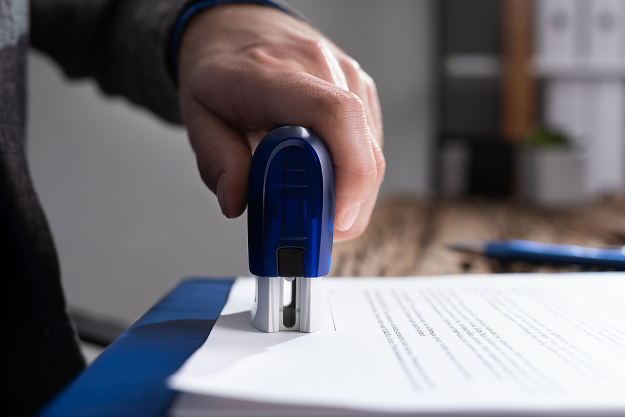 man using date stamps in a document